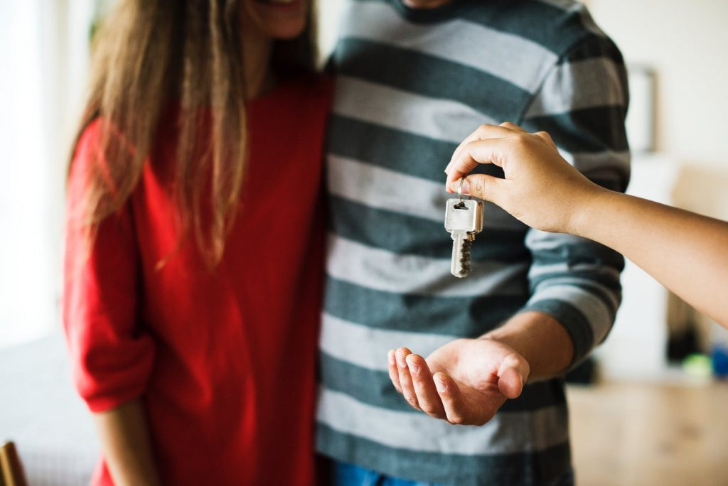 couple being handed keys to their home.