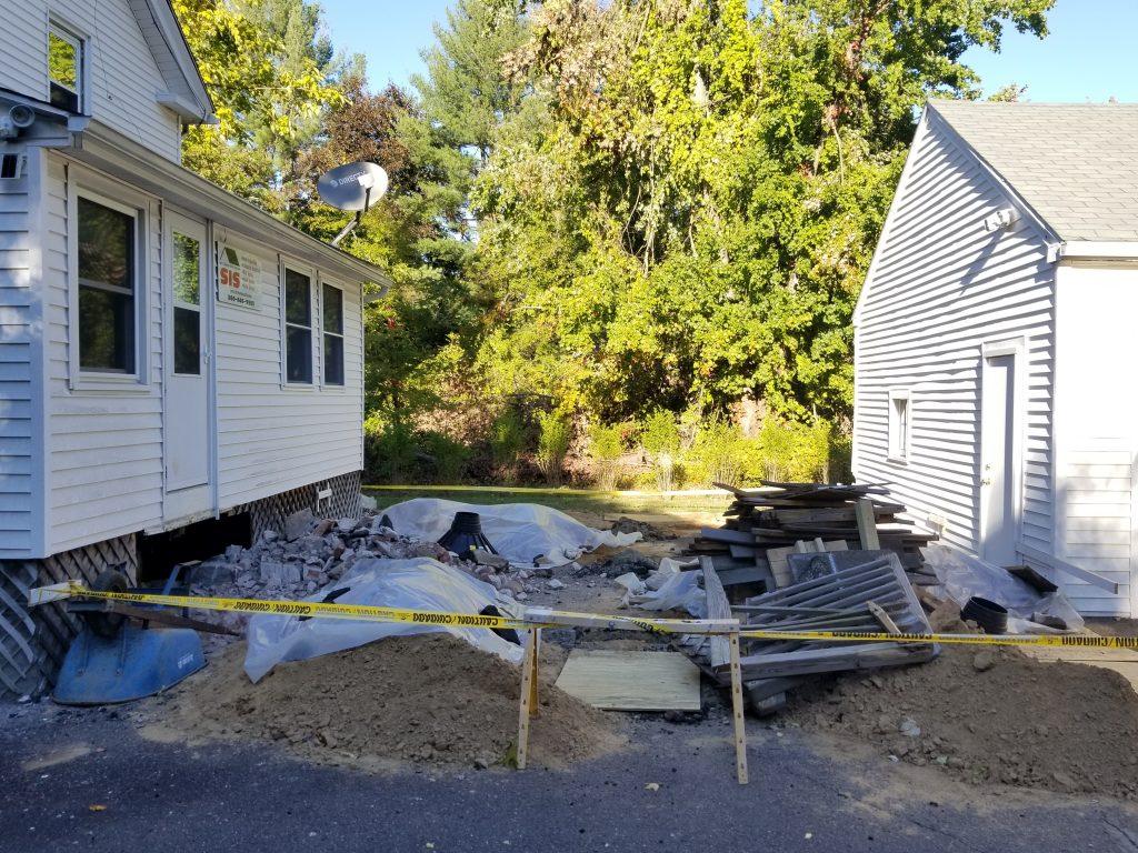Holes dug and stairs demolished